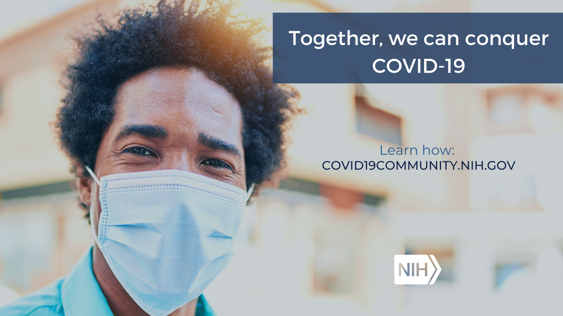 "A man in a mask smiles at the camera with the phrase, ""Let's conquer COVID-19 together. Learn more: covid19community.nih.gov"""